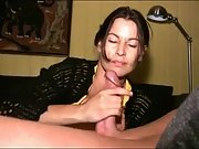 Spectacular brown-haired milf jerks cock to orgasm